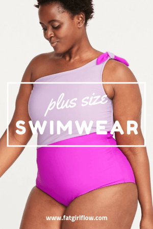 "person with natural hair wearing a baby pink and magenta one piece. suit is a one strap colorblock style with baby pink on the top and magenta on the bottom. white text over top reads ""plus size swimwear"""