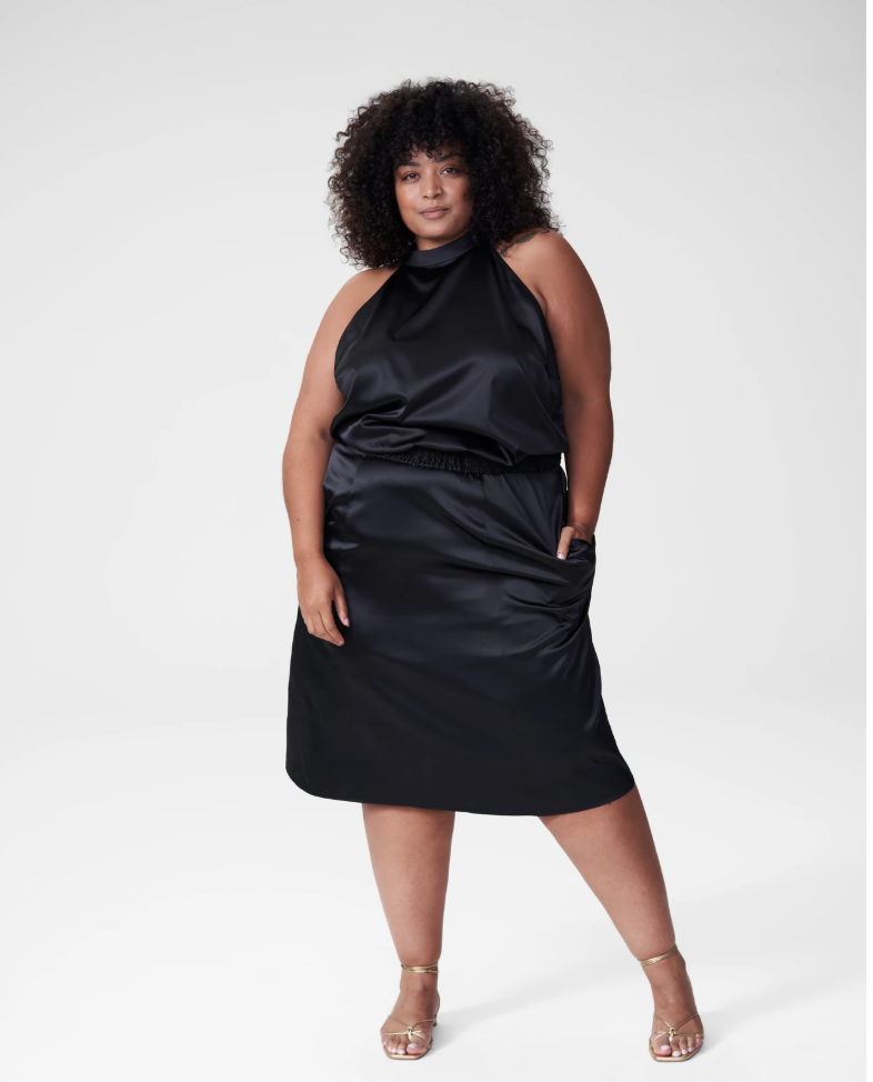plus size woman wearing smooth satin skirt